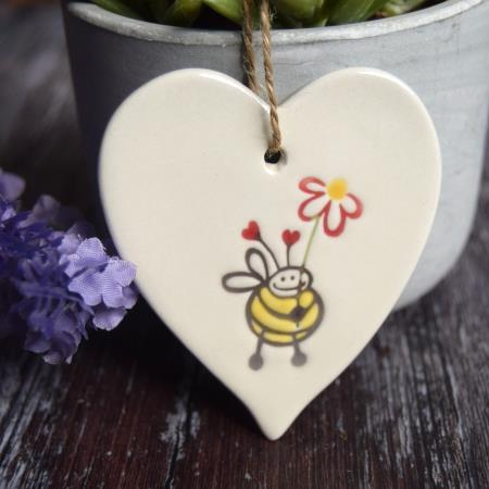 bee with flower by Broadlands Pottery
