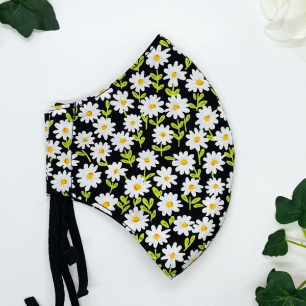 Daisies face mask by sarah louise hardwick