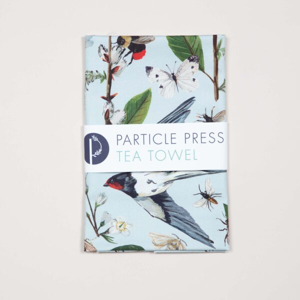 swallows & blossom tea towel by particle press