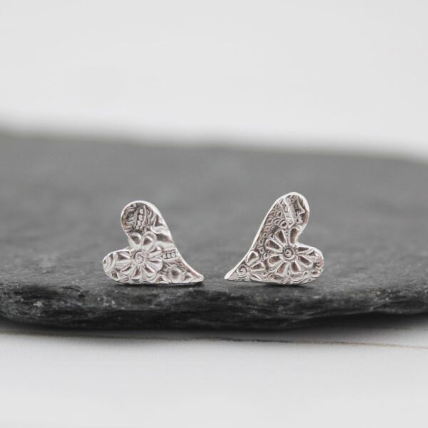 sterling silver tilted heart studs by lucy kemp jewellery