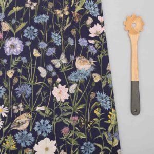 goldcrest & cornflower navy tea towel by particle press