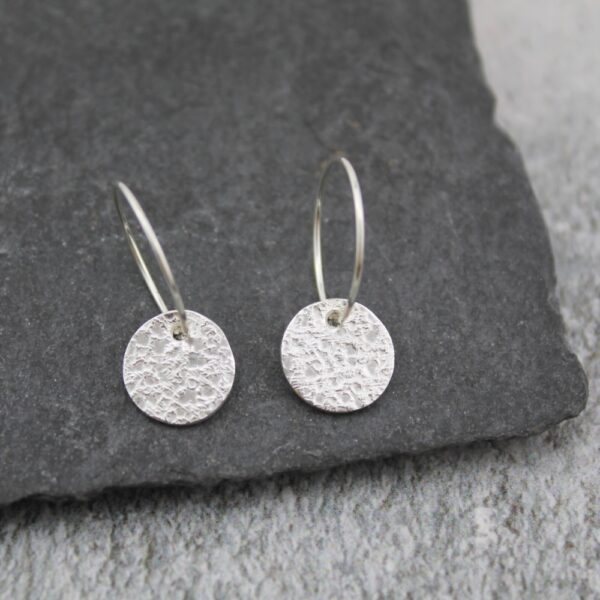 Silver Textured Circle Charm Hoops By lucy kemp