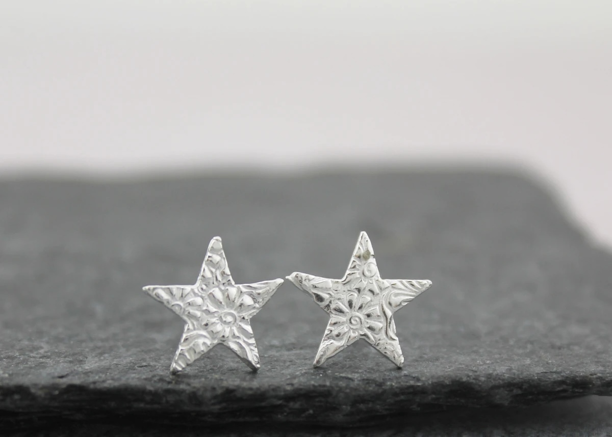 Handmade sterling islver star studs by lucy kemp jewellery